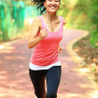 Asian woman jogging at park — Stock Photo #41932567