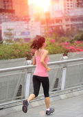Running at city asphalt street — Stock Photo