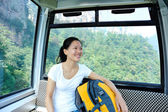 Woman tourist travel in cable ca — Stock Photo