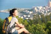 Woman hiker sit seaside — Stock Photo