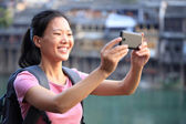 Young asian woman use smart phone — Stock Photo