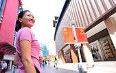 Woman smile on shopping street — Stock Photo