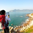 Hiking woman use digital tablet taking photo — Stock Photo