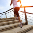 Woman running on stone stairs seaside — Stock Photo #42328187