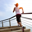 Woman running on stone stairs seaside — Stock Photo #42328211