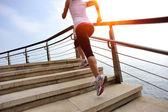 Woman running on stone stairs seaside — Stock Photo