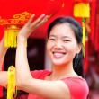 Woman wishing you a happy chinese new year — Stock Photo #42438885