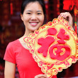 Woman wishing you a happy chinese new year — Stock Photo #42438983