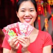Woman wishing you a happy chinese new year — Stock Photo #42438997