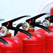 Red fire extinguisher — Stock Photo #42444183