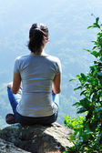Yoga woman sit on rock — Stock Photo