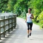 Asian woman jogging at park — Stock Photo
