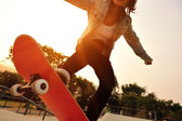 Sneakers on a skateboard — Stock Photo