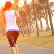 Woman running in tropical park — Stock Photo #43687991