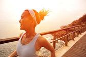 Running woman on bridge — Stock Photo
