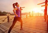 Running woman on bridge — Stok fotoğraf