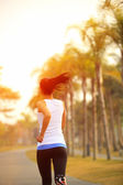 Woman running in tropical park — Stock Photo