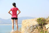Woman on seaside mountain — Stock Photo