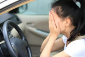 Sad woman driver in car — Stock Photo