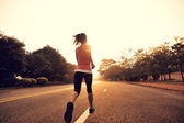 Runner athlete running at road — 图库照片