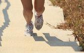 Runner athlete legs running on mountain stone stair — Stock Photo