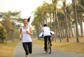 Runner athlete running at tropical park. — Stock Photo