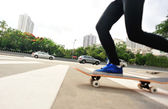 Skateboarding woman — Stock Photo