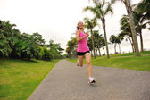 Runner athlete running at tropical park. — Stock Photo