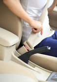 Woman driver buckle up — Stock Photo