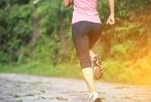 Runner athlete running at tropical park — Stock Photo