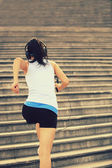 Runner athlete running on stairs — Stock Photo
