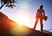 Skateboarder at sunrise — Stock Photo