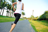 Runner athlete running on tropical park trail — Stock Photo