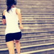 Runner athlete running on stairs. — Stock Photo