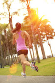 Woman athlete running at park — Stock Photo