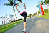 Woman athlete running at park — Stock Photo