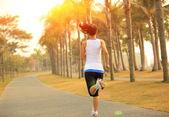 Runner athlete running on tropical park trail — Stock Photo