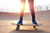 Legs in blue shoes skateboarding — Foto Stock