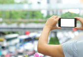 Woman taking photo with smart phone — Stock Photo