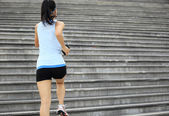 Woman athlete running on stairs. — Stock Photo