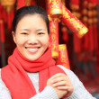 Woman wishing you a happy chinese new year — Stock Photo #48699573
