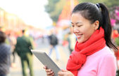 Woman use digital tablet — Stock Photo