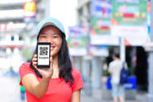 Young asian woman hold smart phone — Stock Photo