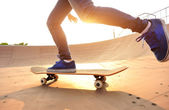 Skateboarding woman legs — Stock Photo