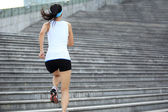 Woman running on stairs — Foto Stock