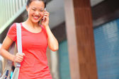 Young asian woman on the phone — Stockfoto