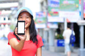 Young asian woman hold blank smart phone — Stock Photo