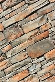 Cracked real stone wall surface with cement — Stock Photo