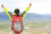 Cheering hiking woman open arms — Stock Photo