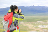 Woman photographer taking photo at plateau mountain — Stock Photo